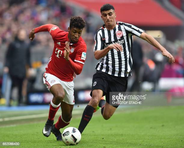 Bayern Munich's French forward Kingsley Coman and Frankfurt's midfielder Aymen Barkok vie for the ball during the German First division Bundesliga...