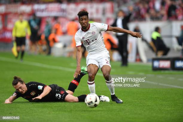 Bayern Munich's French forward Kingsley Coman and Leverkusen's Austrian midflielder Julian Baumgartlinger and vie for the ball during the German...
