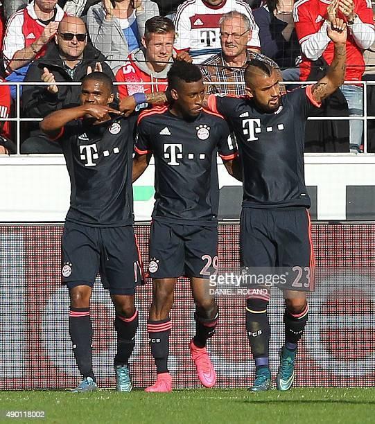 Bayern Munich's French forward Kingsley Coman celebrates scoring the 30 with Bayern Munich's Brazilian midfielder Douglas Costa and Bayern Munich's...