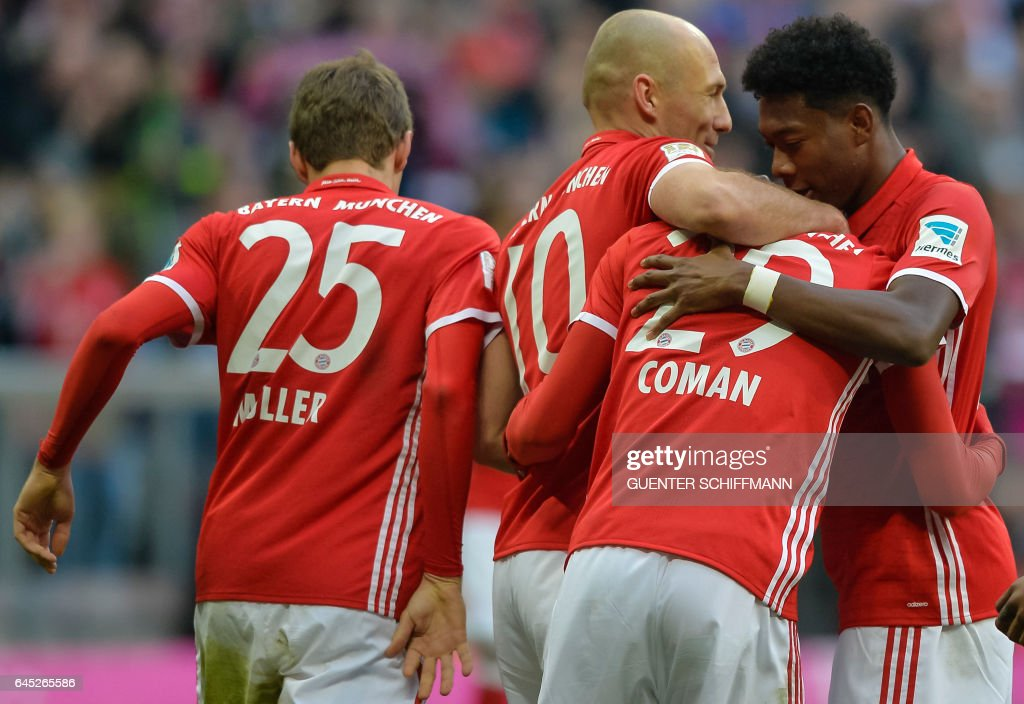 Bayern Munich's French forward Kingsley Coman (2ndR) celebrates with his teammates the seventh goal during the German first division Bundesliga football match between Bayern Munich and Hamburger SV in Munich, southern Germany, on February 25, 2017. / AFP / Guenter