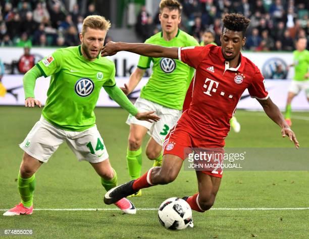Bayern Munich's French forward Kingsley Coman vies with Wolfsburg's Polish midfielder Jakub Blaszczykowski during the German first division...