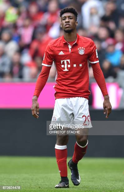 Bayern Munich's French forward Kingsley Coman walks over the pitch during the German first division Bundesliga football match between FC Bayern...