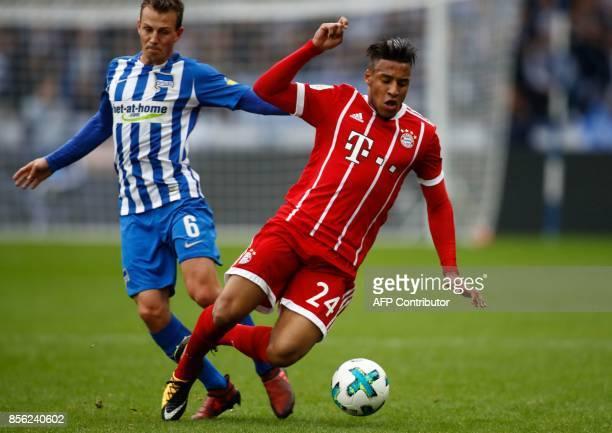 Bayern Munich's French midfielder Corentin Tolisso and Berlin's Czech midfielder Vladimir Darida vie for the ball during the German first division...