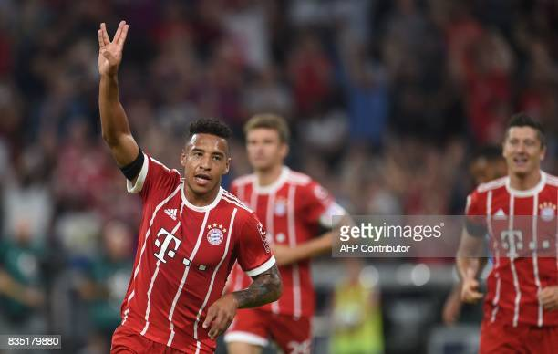 Bayern Munich's French midfielder Corentin Tolisso celebrates scoring during the German First division Bundesliga football match FC Bayern Munich vs...