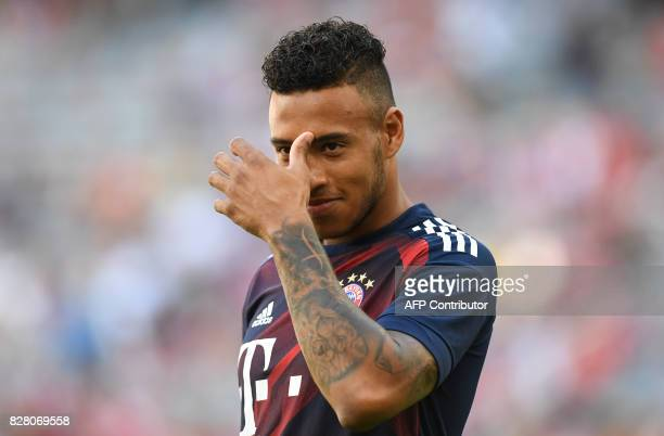 Bayern Munich's French midfielder Corentin Tolisso laughs prior the third place Audi Cup football match between SSC Napoli and Bayern Munich in the...