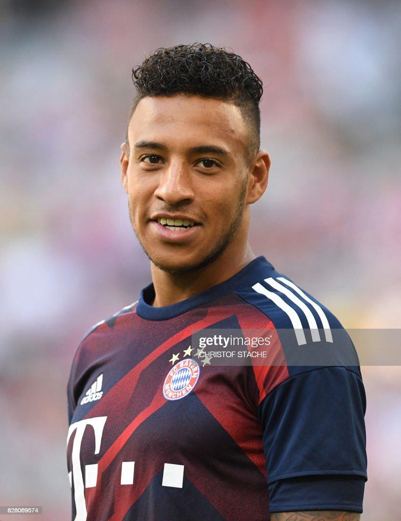 Bayern Munich s French midfielder Corentin Tolisso laughs prior