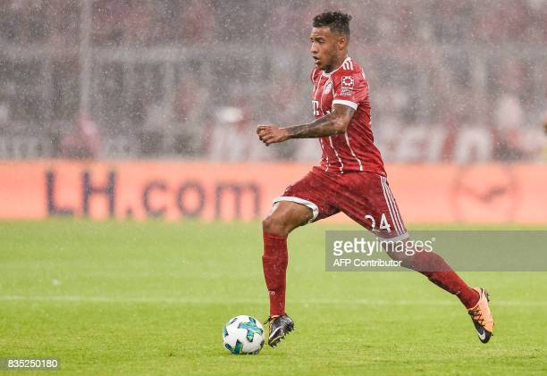 Bayern Munich's French midfielder Corentin Tolisso runs with the ball during the German first division Bundesliga football match FC Bayern Munich vs...