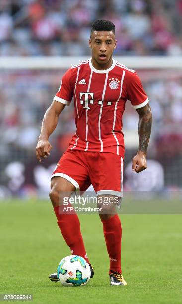 Bayern Munich's French midfielder Corentin Tolisso vie for the ball during the third place Audi Cup football match between SSC Napoli and Bayern...