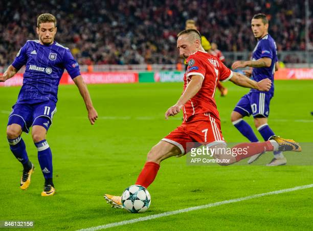 Bayern Munich's French midfielder Franck Ribery and Anderlecht's Romanian forward Alecandru Chipciu vie for the ball during the Champions League...