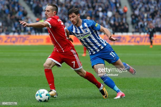 Bayern Munich's French midfielder Franck Ribery and Berlin's Australian midfielder Mathew Leckie vie for the ball during the German first division...