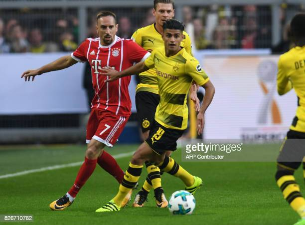 Bayern Munich's French midfielder Franck Ribery and Dortmund's midfielder Mahmoud Dahoud vie for the ball during the German Supercup football match...