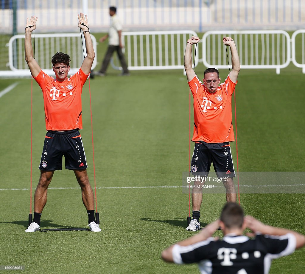 Bayern Munich's French midfielder Franck Ribery (R) and German striker Mario Gomez (L) attend a training session at the Aspire Academy for Sports Excellence in Doha on January 6, 2013. Bayern Munich is in Qatar for a week-long training camp before the beginning of the new season of the German Bundesliga after the winter break.