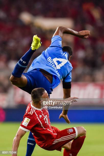Bayern Munich's French midfielder Franck Ribery and Leverkusen's German defender Jonathan Tah vie for the ball during the German First division...