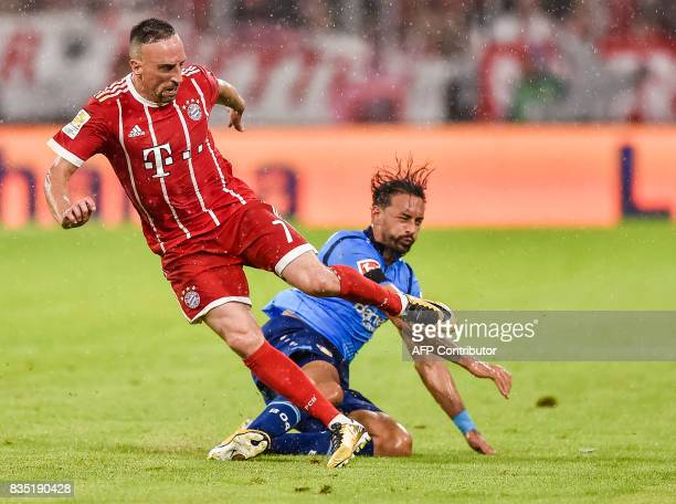Bayern Munich's French midfielder Franck Ribery and Leverkusen's German midfielder Karim Bellarabi vie for the ball during the German First division...