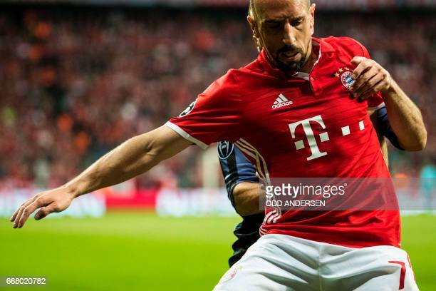 Bayern Munich's French midfielder Franck Ribery and Real Madrid's defender Dani Carvajal vie for the ball during the firstleg quarter final Champions...