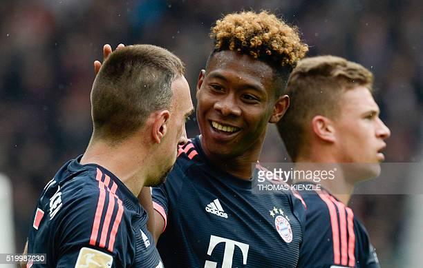 Bayern Munich's French midfielder Franck Ribery Austrian defender David Alaba and midfielder Joshua Kimmich react after Alaba scored during the...