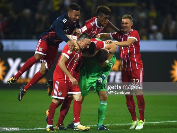 Bayern Munich's French midfielder Franck Ribery Bayern Munich's goalkeeper Sven Ulreich Bayern Munich's midfielder Joshua Kimmich celebrate after...