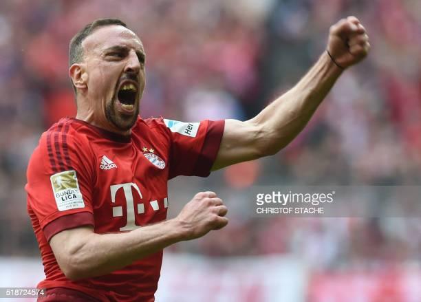 Bayern Munich's French midfielder Franck Ribery celebrates after scoring during the German Bundesliga first division football match between FC Bayern...