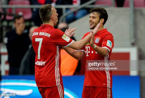 Bayern Munich's French midfielder Franck Ribery celebrates his 03 goal with Bayern Munich's Spanish defender Juan Bernat during the German First...