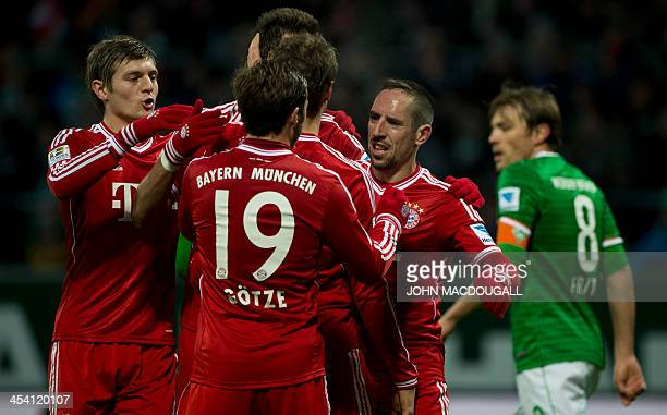 Bayern Munich's French midfielder Franck Ribery celebrates with Bayern Munich's midfielder Thomas Mueller after scoring the third goal during the...