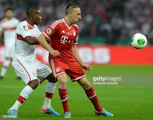 Bayern Munich's French midfielder Franck Ribery fights for the ball with Stuttgart's Guinean midfielder Ibrahima Traore during the football final...