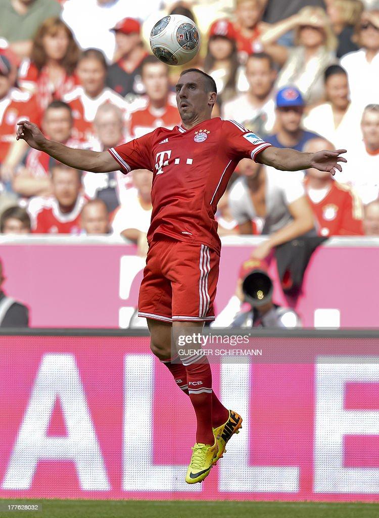 Bayern Munich's French midfielder Franck Ribery heads the ball during the German first division Bundesliga football match FC Bayern Munich vs FC Nuremberg in Munich, southern Germany on August 24, 2013. Bayern Munich won the match 2-0.