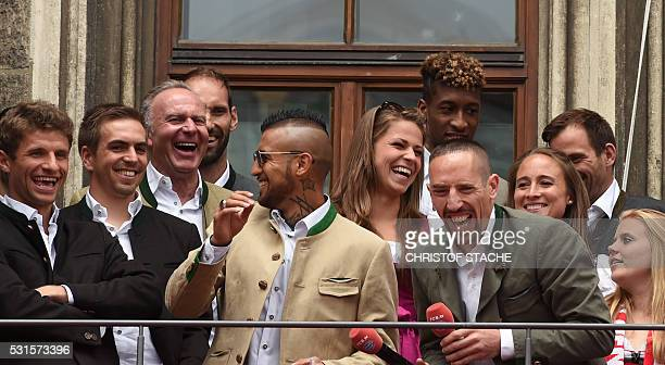 Bayern Munich's French midfielder Franck Ribery jokes with Bayern Munich's Chilian midfielder Arturo Vidal goalkeeper Tom Starke CEO...