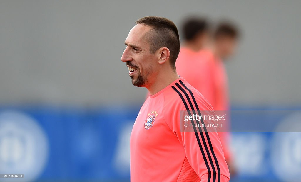 Bayern Munich's French midfielder Franck Ribery laughs during the final team training session one day prior to the Champions League semi-final, second-leg football match between Bayern Munich and Atletico Madrid at the club trainings area in Munich, southern Germany, on May 2, 2016. / AFP / CHRISTOF