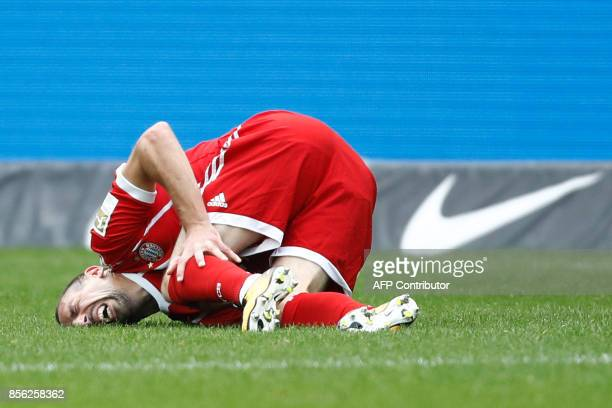 TOPSHOT Bayern Munich's French midfielder Franck Ribery lays on the pitch after injuring his knee during the German first division Bundesliga...