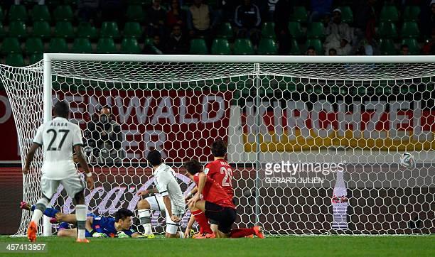 Bayern Munich's French midfielder Franck Ribery scores a goal during the semifinal football match Guangzhou Evergrande FC against FC Bayern Munchen...