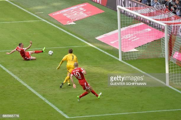 Bayern Munich's French midfielder Franck Ribery scores during the German first division Bundesliga football match FC Bayern Munich vs SC Freiburg in...