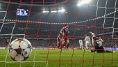 Bayern Munich's French midfielder Franck Ribery scores past Shakhtar Donetsk's goalkeeper Andriy Pyatov during the UEFA Champions League secondleg...