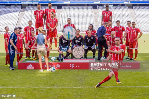 Bayern Munich's French midfielder Franck Ribery shoots on the photographers prior the team photo session of FC Bayern Munich in the southern German...