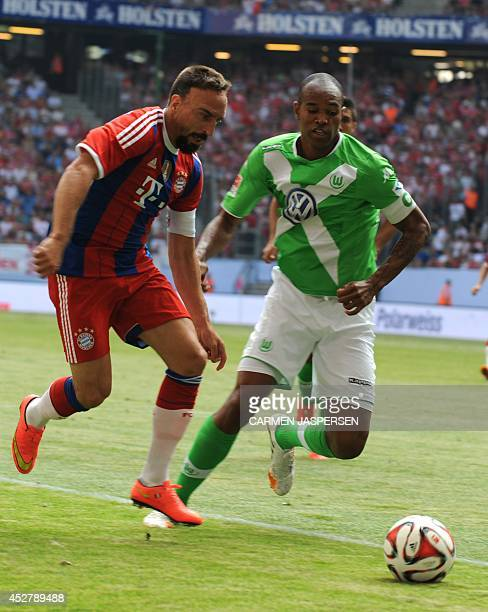 Bayern Munich's French midfielder Franck Ribery vies for the ball with Wolfsburg's Brazilian defender Naldo during the Telekom Cup final football...