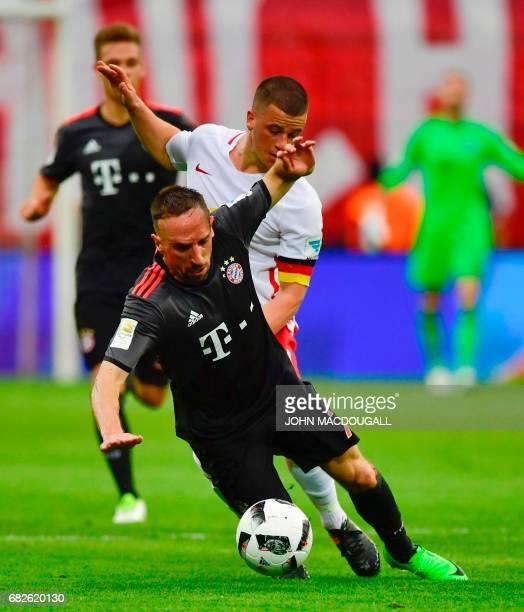 Bayern Munich's French midfielder Franck Ribery vies with Leipzig's midfielder Diego Demme during the German first division Bundesliga football match...
