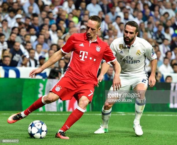 Bayern Munich's French midfielder Franck Ribery vies with Real Madrid's defender Dani Carvajal during the UEFA Champions League quarterfinal second...