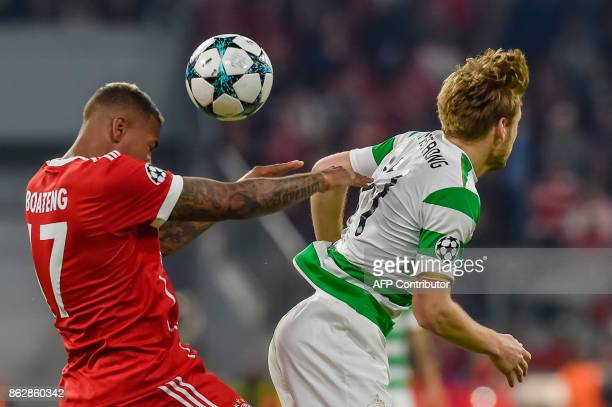 Bayern Munich's German defender Jerome Boateng and Celtic's Scottish midfielder Stuart Armstrong vie for the ball during the Champions League group B...