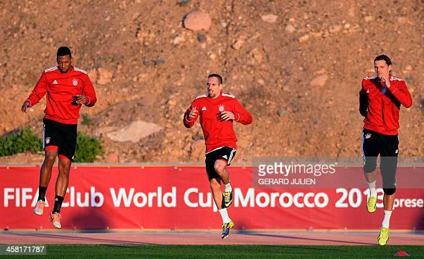 Bayern Munich's German defender Jerome Boateng French midfielder Franck Ribery and Belgian defender Daniel van Buyten take part in a training session...
