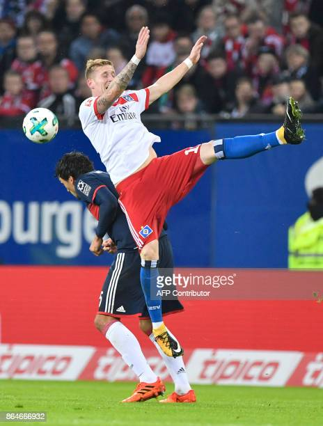 Bayern Munich's German defender Mats Hummels and Hamburg's German forward Andre Hahn vie for the ball during the German first division Bundesliga...