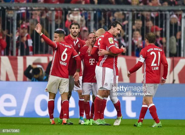 Bayern Munich's German defender Mats Hummels and his team mates celebrate the second goal for their team during the German Cup DFB Pokal semifinal...