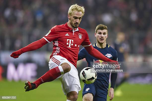 Bayern Munich's German defender Mats Hummels and Leipzig's forward Timo Werner in action during the German first division Bundesliga football match...