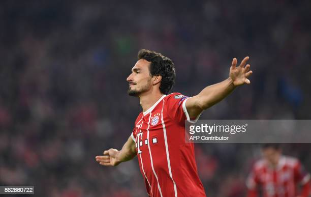 Bayern Munich's German defender Mats Hummels celebrates scoring during the Champions League group B match between FC Bayern Munich and Celtic Glasgow...