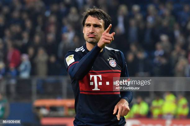 Bayern Munich's German defender Mats Hummels decides whom to give his jersey to after the German first division Bundesliga football match between...