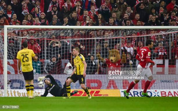 Bayern Munich's German defender Mats Hummels reacts after scoring the second goal during the German Cup DFB Pokal semifinal football match between FC...