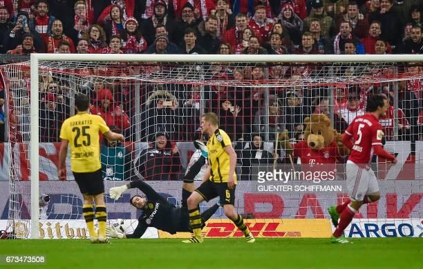 Bayern Munich's German defender Mats Hummels scores the second goal during the German Cup DFB Pokal semifinal football match between FC Bayern Munich...
