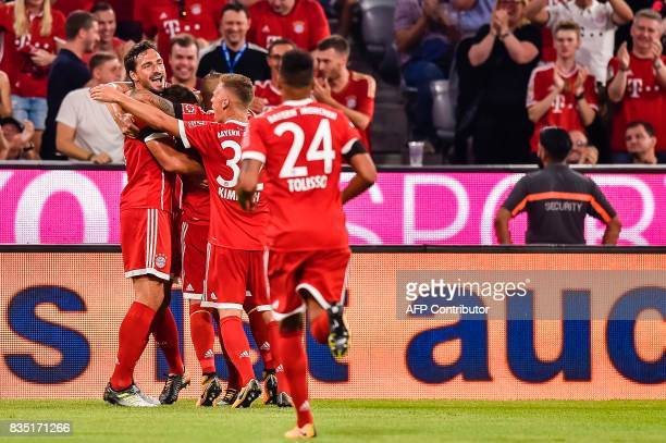 Bayern Munich's German defender Niklas Suele and his team mates celebrate scoring during the German First division Bundesliga football match FC...