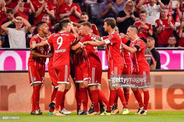 Bayern Munich's German defender Niklas Suele and his team mates celebrate scoring the opening goal of the season during the German First division...