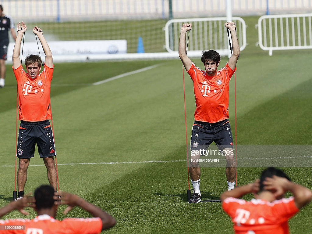 Bayern Munich's German defender Philipp Lahm (L) and Spanish midfielder Javier Martinez (R) attend a training session at the Aspire Academy for Sports Excellence in Doha on January 6, 2013. Bayern Munich is in Qatar for a week-long training camp before the beginning of the new season of the German Bundesliga after the winter break.