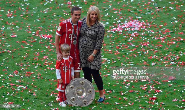 Bayern Munich's German defender Philipp Lahm poses with his pregnent wife Claudia and his sun Julian after the German First division Bundesliga...