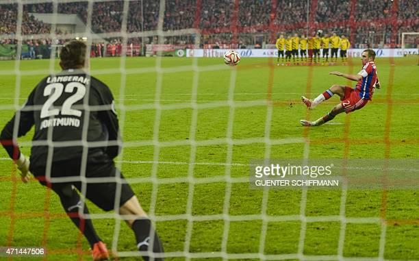 Bayern Munich's German defender Philipp Lahm slips and fails to score the penalty past Dortmund's Australian goalkeeper Mitchell Langerak during the...